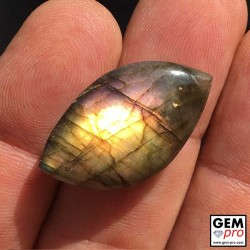 Golden pink labradorite cabochon 27.8 carat from Madagascar free form shape
